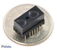 Sharp GP2Y0D805Z0F, GP2Y0D810Z0F, or GP2Y0D815Z0F digital distance sensor on a US quarter for size reference.