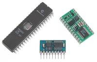 Micro dual serial motor controller next to a 40-pin DIP package and a BASIC Stamp II.
