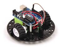 "Pololu 5"" round robot chassis RRC04A with an Arduino Duemilanove and a Sharp digital distance sensor."