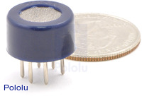 Gas sensor with blue plastic case with quarter for size reference.