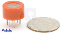 Gas sensor with orange plastic case with quarter for size reference.