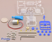 Parts included with the Tamiya 70190 mini motor multi-ratio gearbox (12-speed) kit with quarter for size reference.