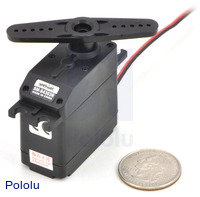 SpringRC SM-S4303R continuous rotation servo with a US quarter for size reference.