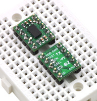 Two MMA7361LC/MMA7341LC 3-axis accelerometers plugged into a breadboard.