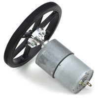 Black Pololu 90×10mm wheel on a Pololu 37Dmm metal gearmotor.