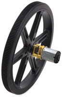 Black Pololu 90×10mm wheel on a Pololu micro metal gearmotor.