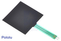 Force-sensing resistor (1.5″ square), bottom side with masked adhesive backing.