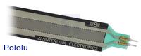 Force-sensing resistor (24″×0.4″ strip) close-up view with solder tabs.
