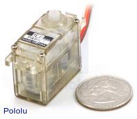 GWS PARK L mini servo with U.S. quarter for size reference.