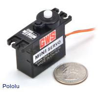 GWS MINI mini servo with U.S. quarter for size reference.
