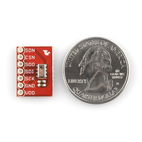 MPL115A1 barometric pressure sensor breakout board, top view with U.S. quarter for size reference.