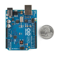 Arduino Uno SMD edition, top view, with U.S. quarter for size reference.