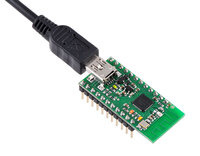 Wixel programmable USB wireless module (fully assembled) with USB cable connected.