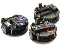 Fleet of m3pi robots: ARM's original m3pi (left) and Pololu's m3pis (right).