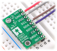 L3G4200D/L3GD20 3-axis gyro carrier with voltage regulator in a breadboard.