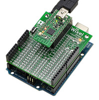 Wixel shield for Arduino powered through its power jack with Wixel's USB port connected.