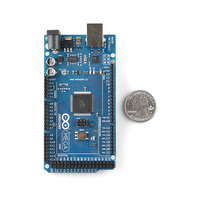 Arduino Mega 2560, top view with quarter for size reference.