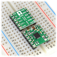 DRV8801 single brushed DC motor driver carriers inserted into a solderless breadboard.