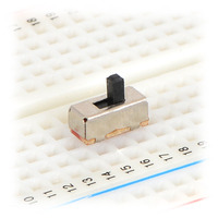 Mini slide switch in a solderless breadboard.