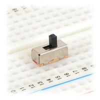 Mini slide switch in a solderless breadboard.