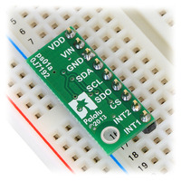 LPS331AP pressure/altitude sensor carrier with voltage regulator in a breadboard.