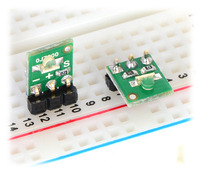 QTR-L-1A and QTR-L-1RC reflectance sensors plugged into a breadboard in two possible orientations.