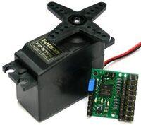 Pololu Micro Serial Servo Controller next to a standard-size RC servo.
