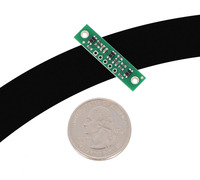 """QTR-3A or QTR-3RC reflectance sensor array on a 3/4"""" line with a quarter for size reference."""