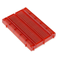 SparkFun Inventor's Kit translucent red 400-point breadboard.