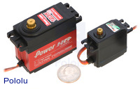 Power HD digital giant servo 1235MG (left) next to a Power HD high-torque standard-size servo 1501MG (right), with a US quarter for size reference.