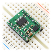 A4990 dual motor driver carrier inserted into a solderless breadboard.
