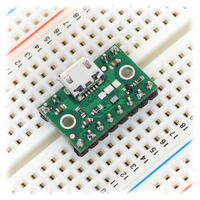 FPF1320 power multiplexer carrier with USB Micro-B connector in a breadboard.