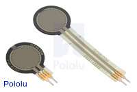 0.6″-diameter short-tail force sensing resistor (FSR) next to a 0.6″-diameter FSR with a standard tail.