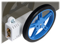 60×8mm Pololu wheel and 90° mini plastic gearmotor mounted with a wide mini plastic gearmotor bracket (with spacer).
