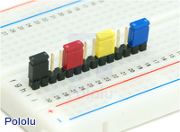 "0.100"" (2.54 mm) shorting blocks of assorted colors on a 0.1"" header strip."