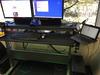 Motorizing a crank-powered adjustable-height desk