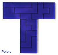 A pentomino piece, showing engraved solution.